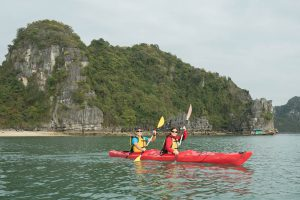 Paddling in Sync at Halong Bay