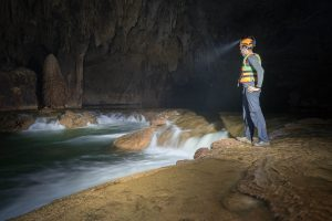Waterfall in Kim Cave on Tu Lan Expedition